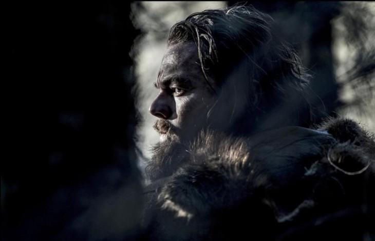 Leonardo DiCaprio in a mountain man beard, looking stern